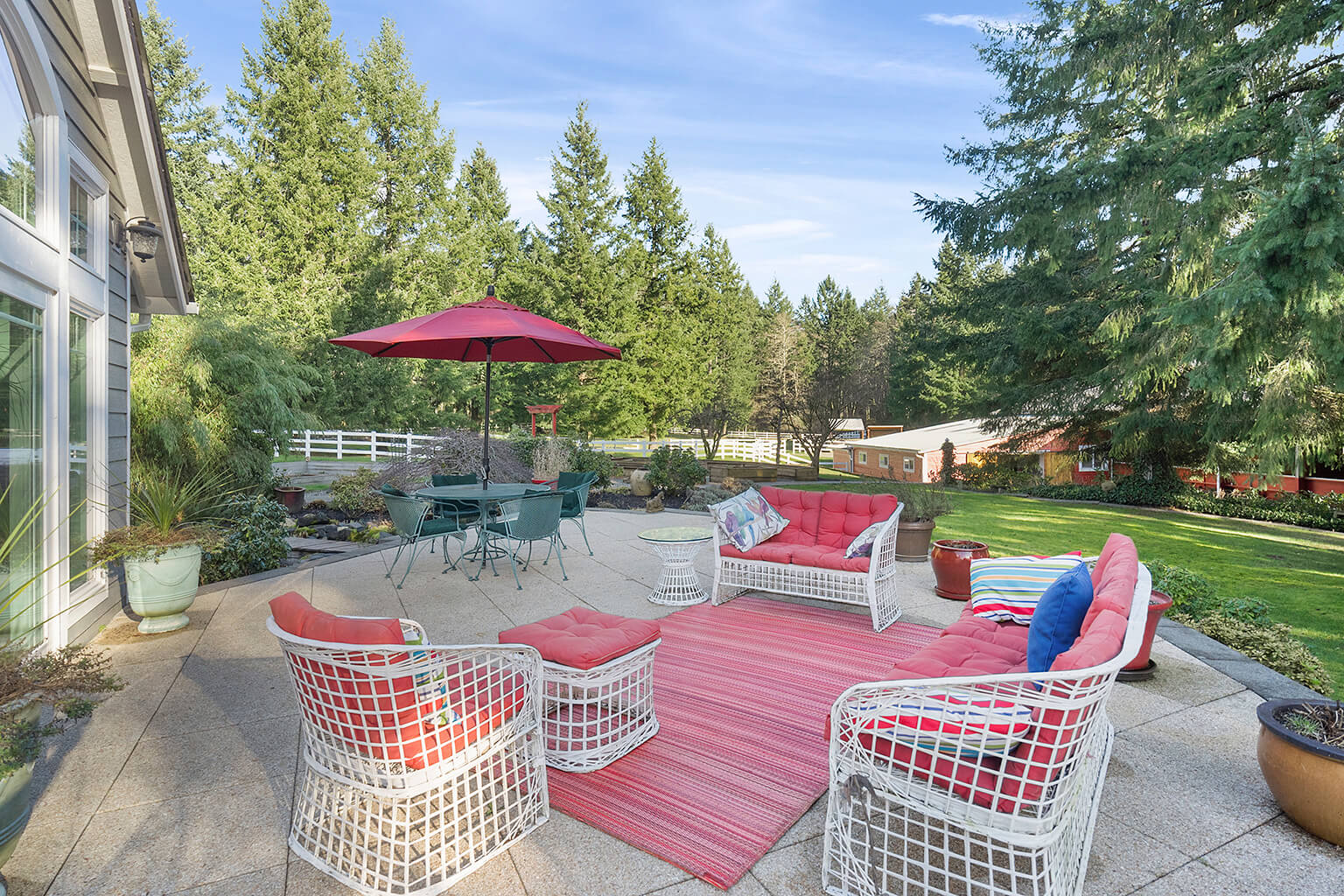 Spacious patio off the great room overlooking the horse facilities