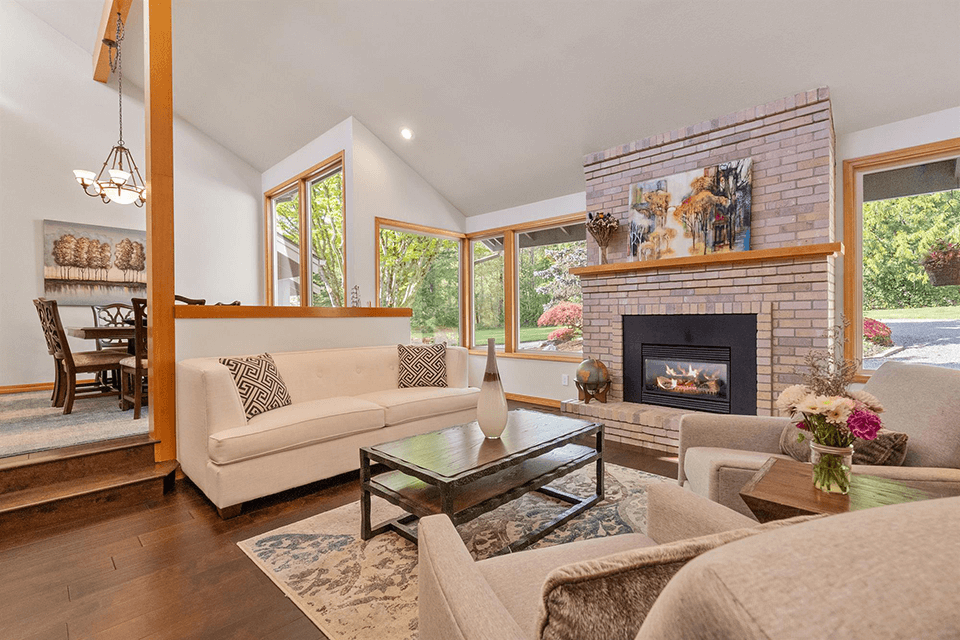 Step down living room with gas fireplace and vaulted ceiling