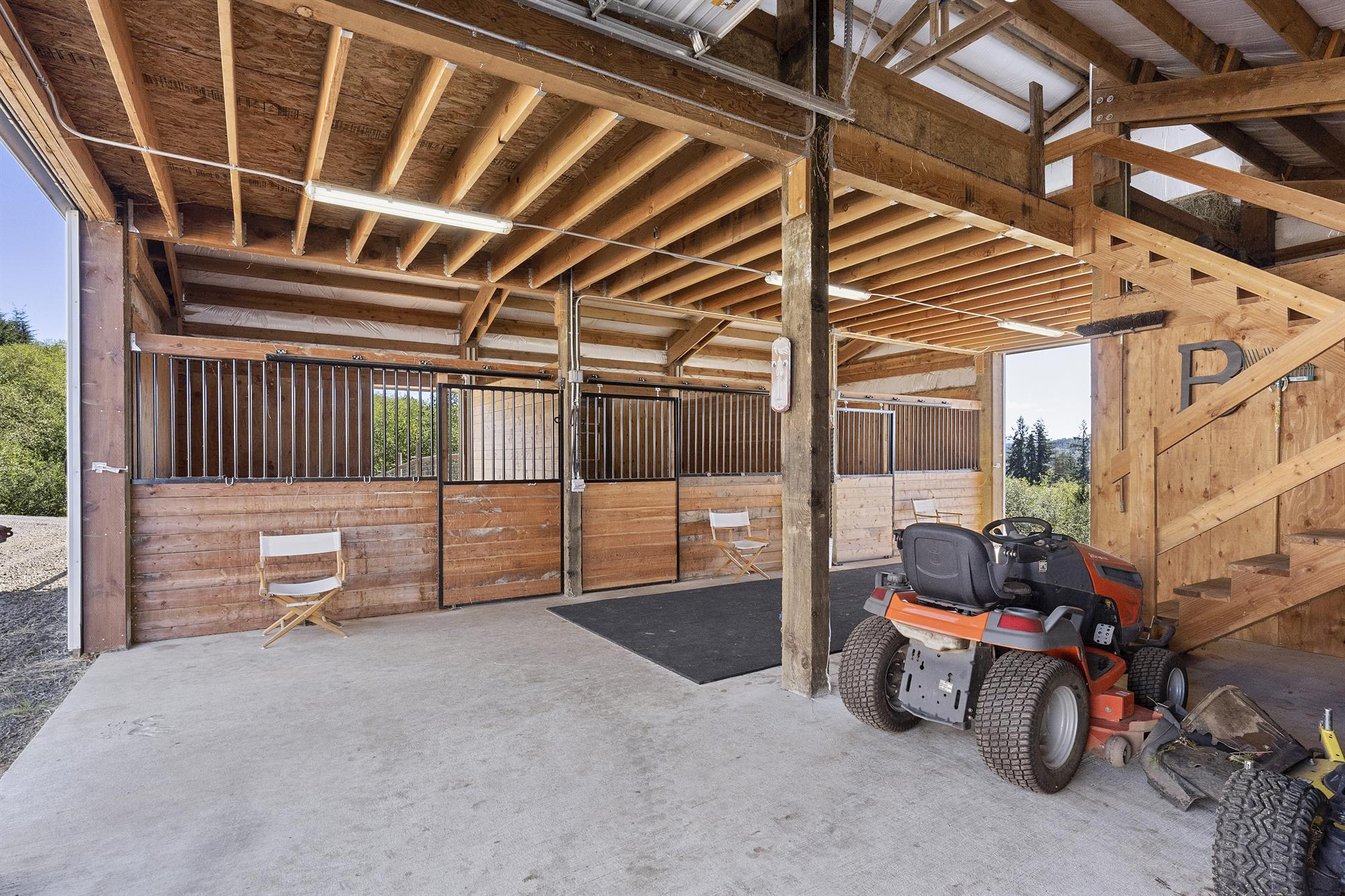 Barn includes three 12' x 12' rubber matted stalls, hot water and a 12-ton hay loft