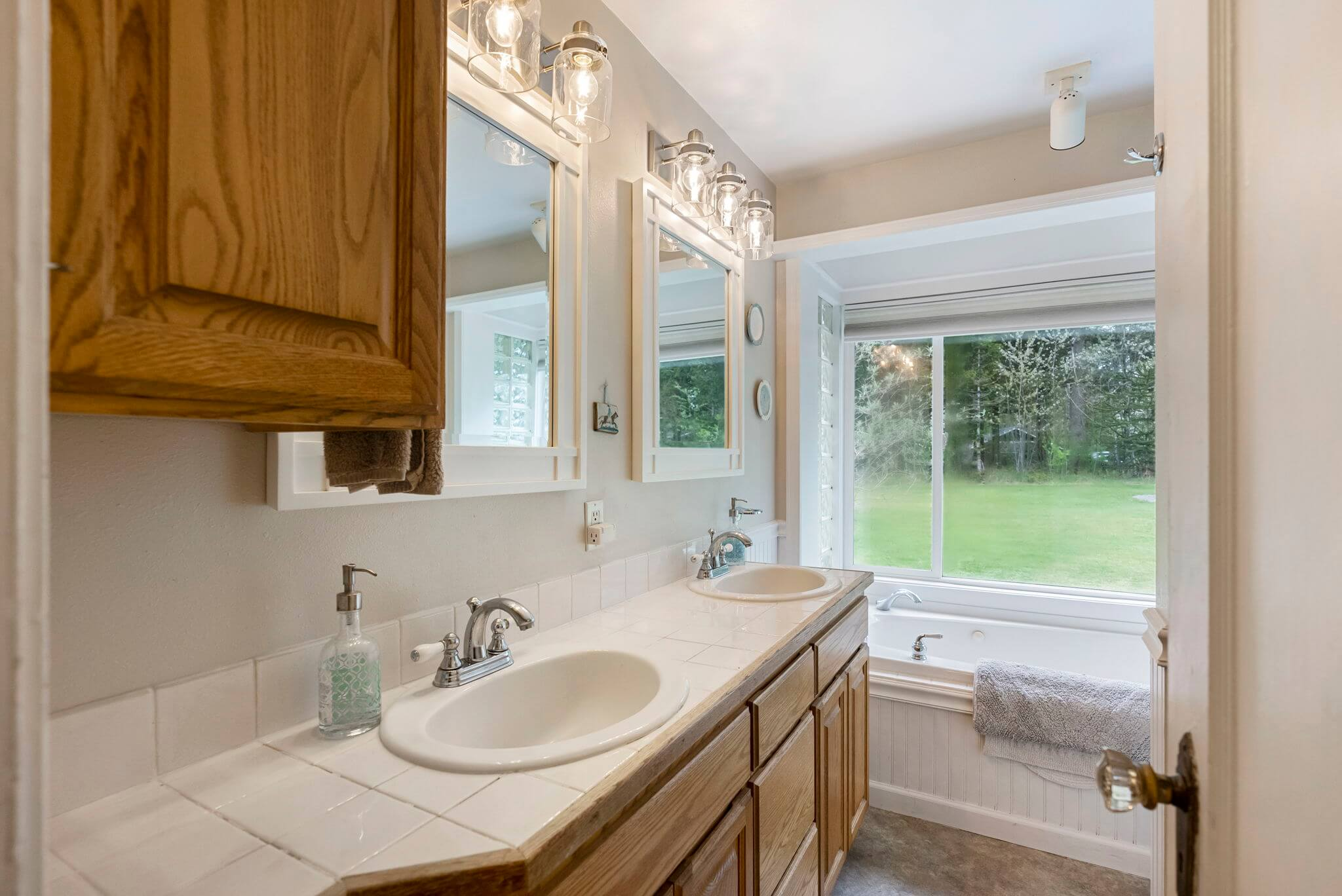 Bathroom with dual sink vanity, jetted soaking tub and separate shower
